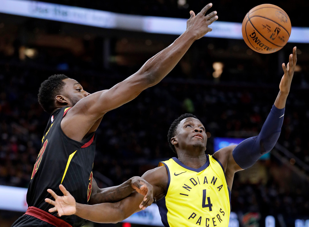 . Cleveland Cavaliers\' Jeff Green, left, and Indiana Pacers\' Victor Oladipo (4) battle for a rebound in the first half of Game 1 of an NBA basketball first-round playoff series Sunday, April 15, 2018, in Cleveland. (AP Photo/Tony Dejak)
