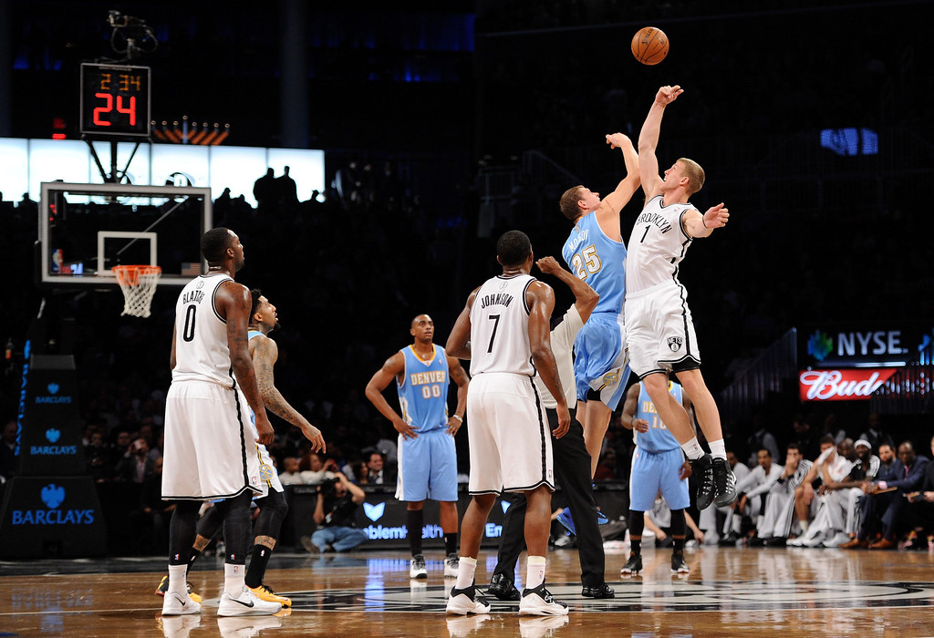 . NEW YORK, NY - DECEMBER 03:  Mason Plumlee #1 of the Brooklyn Nets and Timofey Mozgov #25 of the Denver Nuggets compete for a jump ball during the first quarter at Barclays Center on December 3, 2013 in the Brooklyn borough of New York City.  (Photo by Maddie Meyer/Getty Images)