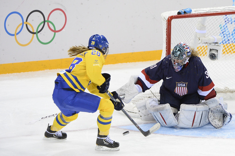 . Sweden\'s Michelle Lowenhielm (L) tries to score on US goalkeeper Jessie Vetter (R) during the Women\'s Ice Hockey Semifinals USA vs Sweden at the Shayba Arena during the Sochi Winter Olympics on February 17, 2014.   AFP PHOTO / JONATHAN NACKSTRANDJONATHAN NACKSTRAND/AFP/Getty Images