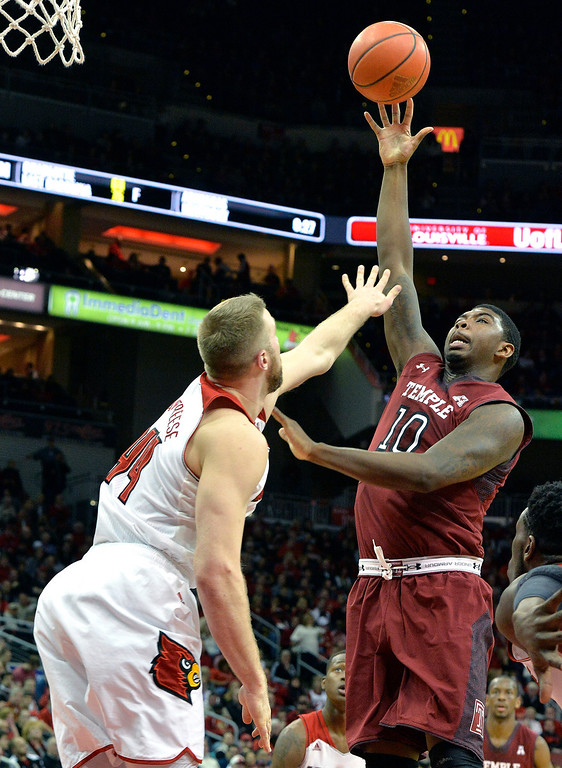 . Temple\'s Mark Williams, right, puts up a shot over Louisville\'s Stephan Van Treese during the first half of an NCAA college basketball game, Thursday, Feb. 27, 2014, in Louisville, Ky. (AP Photo/Timothy D. Easley)