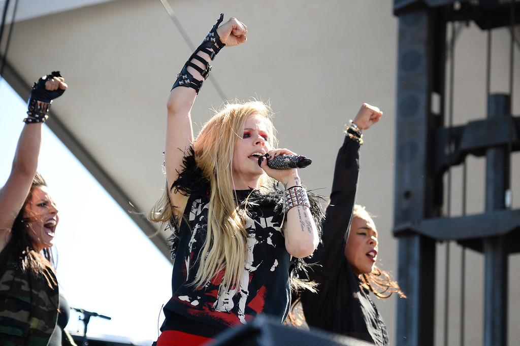 . Avril Lavigne performs at IHeartRadio Music Village, Saturday, Sept. 21, 2013 in Las Vegas. (Photo by Al Powers/Powers Imagery/Invision /AP)
