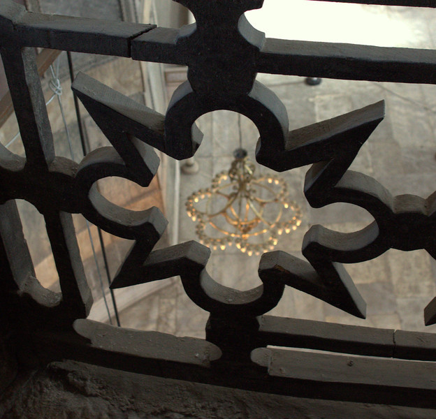 Looking through ironwork on upper level.