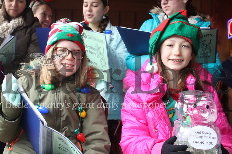 ) Harold Aughton/Special to the Eagle: Lauren Chadwick, 10, and Grace Wilson, 10, of Mars Girl Scout Troop 28842 sang Christmas Carols collecting money for the less fortunate Saturday morning outside a local business along Route 8. (Dave's Meats along Route 8) Harold Aughton/Special to the Eagle