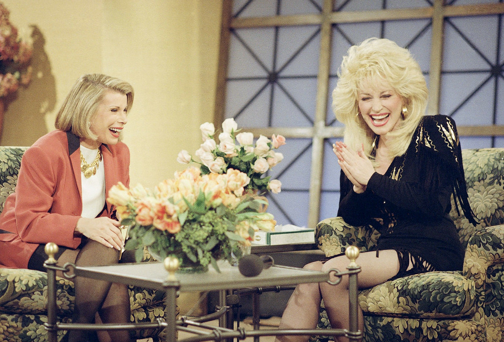 ". Dolly Parton, right, appears with host Joan Rivers during taping, Monday, March 1, 1993 in New York of ""The Joan Rivers Show,\"" which will air on March 3rd. Ms. Parton performed hits from her new album, ?Slow Dancing with the Moon.? (AP Photo/Joe Tabacca)"