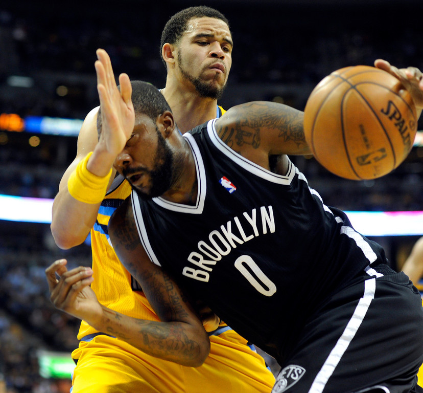 . DENVER, CO. - MARCH 29: JaVale McGee (34) of the Denver Nuggets played tight defense on Andray Blatche (0) of the Brooklyn Nets in the second half. The Denver Nuggets defeated the Brooklyn Nets 109-87 Friday night, March 29, 2013 at the Pepsi Center in Denver.  (Photo By Karl Gehring/The Denver Post)