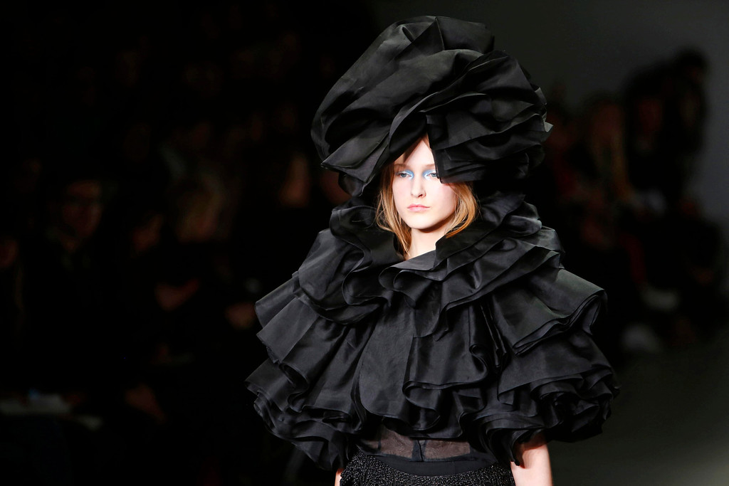 . A model presents a creation from the Fall/Winter 2014 collection by Hong Kong born British fashion designer John Rocha at the London Fashion Week, in London, Britain, 15 February 2014. The event runs from 14 to 18 February.  EPA/TAL COHEN