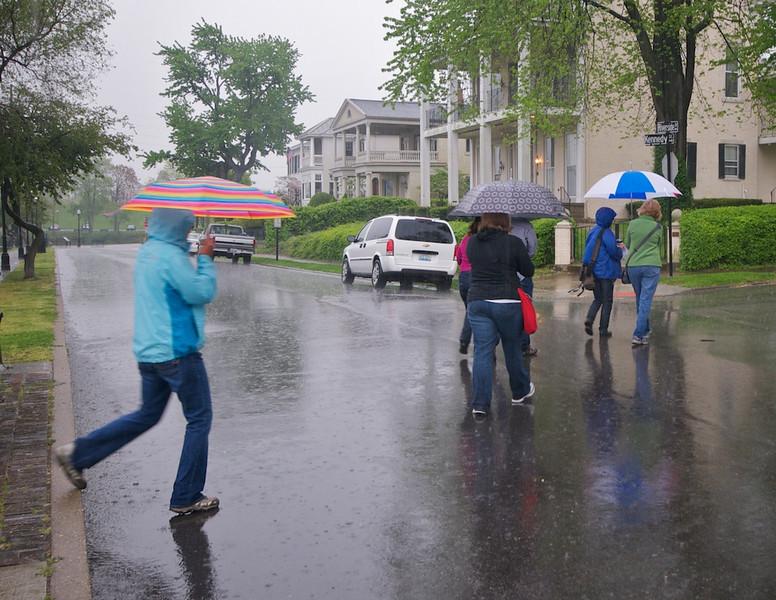 Hardy tourgoers in the rain