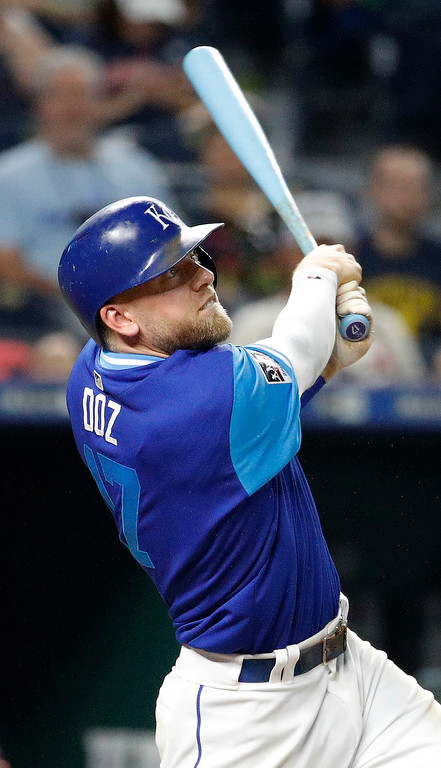 . Kansas City Royals\' Hunter Dozier watches his walk-off home run against the Cleveland Indians in a baseball game Friday, Aug. 24, 2018, in Kansas City, Mo. The Royals won 5-4. (AP Photo/Charlie Riedel)