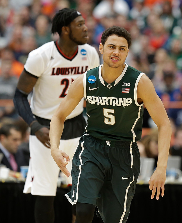. Michigan State\'s Bryn Forbes (5) reacts after making a 3-point basket during the first half of a regional final against Louisville in the NCAA men\'s college basketball tournament Sunday, March 29, 2015, in Syracuse, N.Y. (AP Photo/Seth Wenig)