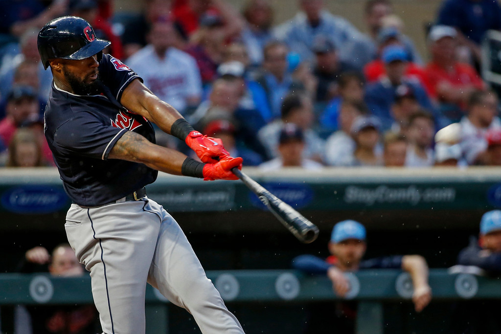 . Cleveland Indians\' Austin Jackson hits a solo home run against the Minnesota Twins in the fourth inning of the second baseball game of a double header Saturday, June 17, 2017, in Minneapolis. (AP Photo/Bruce Kluckhohn)