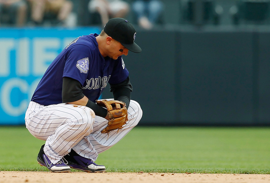 . Colorado Rockies shortstop Troy Tulowitzki reacts after being injured while trying to stop a single off the bat of Washington Nationals\' Ian Desmond in the eighth inning of the Nationals\' 5-4 victory in a baseball game in Denver, Thursday, June 13, 2013. (AP Photo/David Zalubowski)