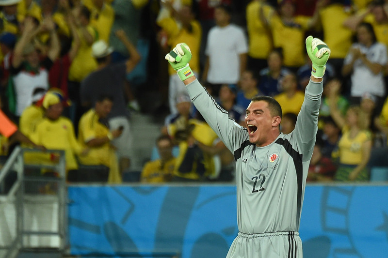. Colombia\'s goalkeeper Faryd Mondragon celebrates after Colombia scored their fourth goal during the Group C football match between Japan and Colombia at the Pantanal Arena in Cuiaba during the 2014 FIFA World Cup on June 24, 2014.  (LUIS ACOSTA/AFP/Getty Images)