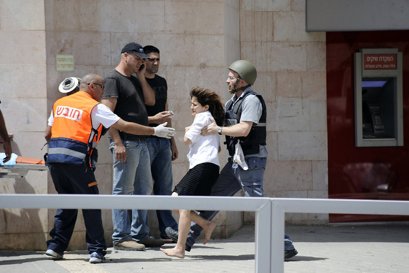 . A woman hostage is evacuated by Israeli security forces following a bank robbery that escalated into a hostage situation in the Israeli city of Beersheva on May 20, 2013. Four people were killed and three others wounded in a botched bank heist in southern Israel which ended when a robber who had held a hostage shot himself dead, police said. DAVID BUIMOVITCH/AFP/Getty Images