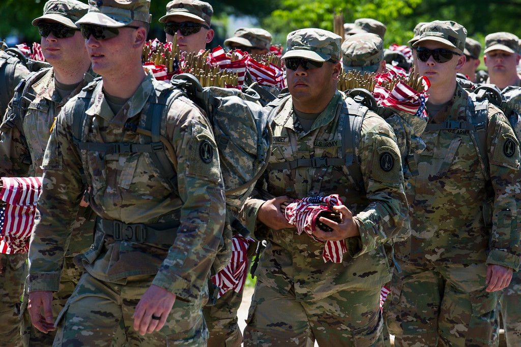 . Members of the Army 3d U.S. Infantry Regiment, The Old Guard, march into Arlington National Cemetery, to participate in their annual Flags In ceremony Thursday, May 24, 2018, in Arlington, Va. (AP Photo/Cliff Owen)