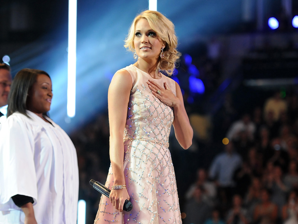 . Carrie Underwood pauses on stage at the 2013 CMT Music Awards at Bridgestone Arena on Wednesday, June 5, 2013, in Nashville, Tenn. (Photo by Frank Micelotta/Invision/AP)