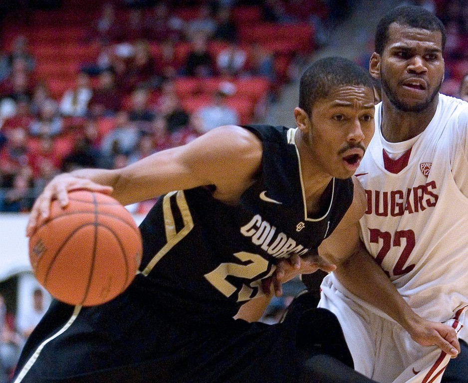 . Colorado guard Spencer Dinwiddie (25) drives against Washington State guard Royce Woolridge (22) during the second half of an NCAA college basketball game Saturday, Jan. 19, 2013, in Pullman, Wash. Dinwiddie lead all scorers with 16 points as Colorado won 58-49. (AP Photo/Dean Hare)