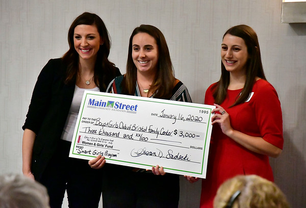 1/16/2020 Mike Orazzi | Staff The Bristol Boys and Girls Club's Sarah Lucien (center) accepts a check from Julia Weston and Jessica Pieri during The Women and Girls Fund of the Main Street Community Foundation grant reception at the DoubleTree Hotel in Bristol on Thursday night.