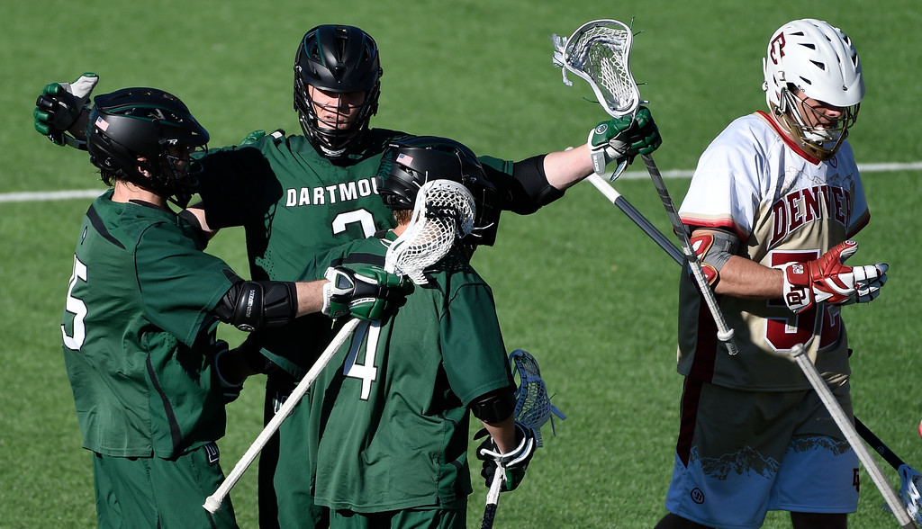 . DENVER, CO - FEBRUARY 28: Dartmouth Jack Korzelius (2) celebrates his goal with Dartmouth KC Beard (15) and Dartmouth Cody George (4) fourth period against the Denver Pioneers during the Face-off Classic February 28, 2016 at Peter Barton Lacrosse Stadium. (Photo By John Leyba/The Denver Post)