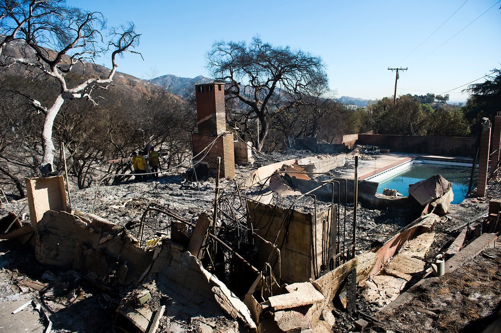 . The remains from of the four homes destroyed by the Colby Fire on Glendora Avenue in Glendora on Friday, Jan. 17, 2014. Glendora residents return to their homes this morning after the mandatory evacuations were lifted. (Photo by Watchara Phomicinda/ San Gabriel Valley Tribune)
