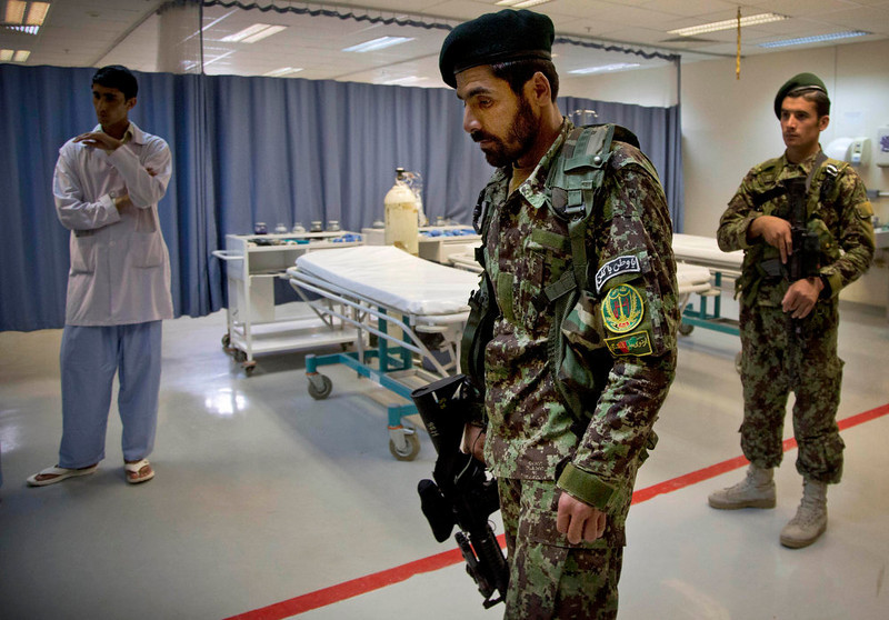 . Afghan Army soldiers pass through the emergency room in the ANA military hospital at the Kandahar Air Base in Kandahar, Afghanistan on Sunday, April 21, 2013. The Afghan NGO Safety Office issued a report in April 2013 saying that the current re-escalation trend in Afghanistan will be preserved throughout the entire season and that 2013 is set to become the second most violent year after 2011, which suffered 2,755 such attacks in the first three months of the year. (AP Photo/Anja Niedringhaus)