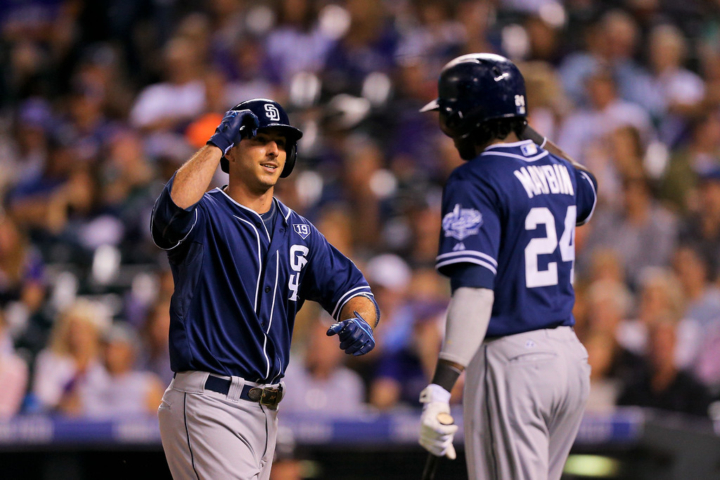 . DENVER, CO - SEPTEMBER 6:  Tommy Medica #14 of the San Diego Padres is congratulated by Cameron Maybin #24 after hitting a solo home run during the fifth inning against the Colorado Rockies at Coors Field on September 6, 2014 in Denver, Colorado. (Photo by Justin Edmonds/Getty Images)