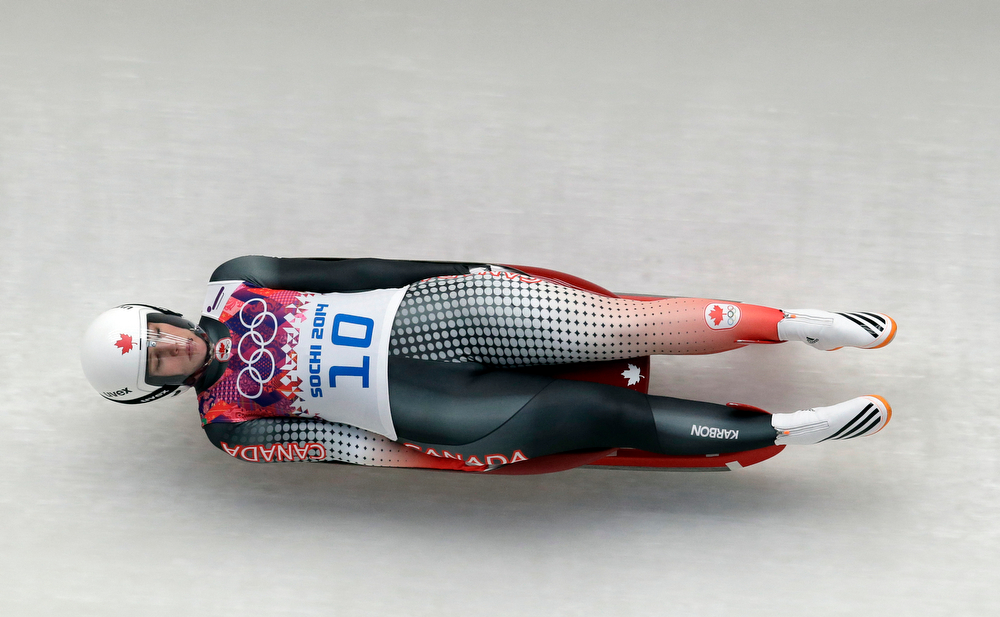 . Alex Gough of Canada speeds down the track in the third run during the women\'s singles luge competition at the 2014 Winter Olympics, Tuesday, Feb. 11, 2014, in Krasnaya Polyana, Russia. (AP Photo/Michael Sohn)
