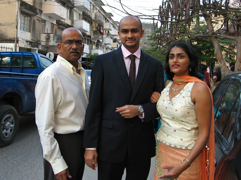 Dad, Sandip, and Bhumisha prepare to enter the hall