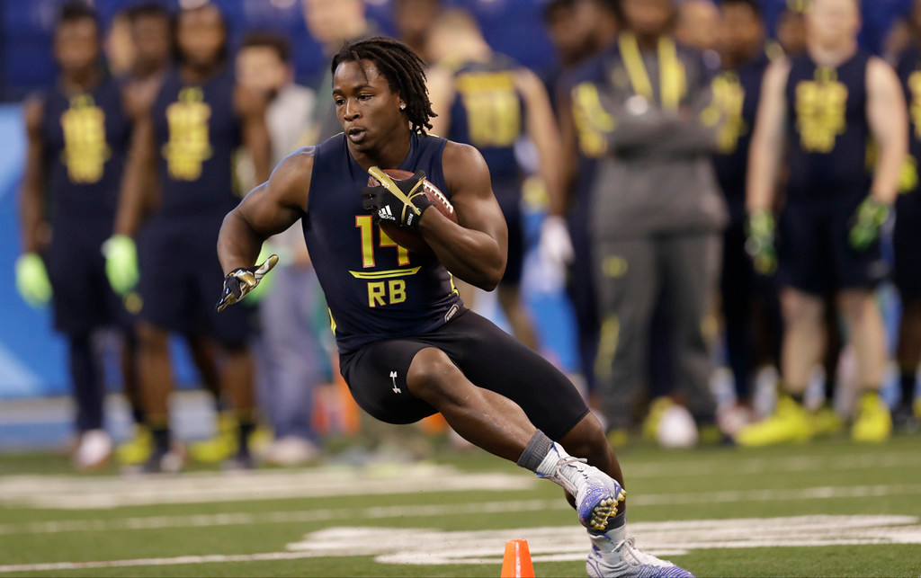 . Toledo running back Kareem Hunt runs a drill at the NFL football scouting combine Friday, March 3, 2017, in Indianapolis. (AP Photo/David J. Phillip)