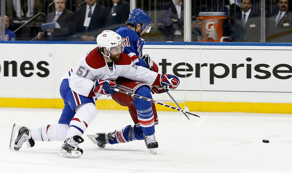 . Montreal Canadiens center David Desharnais (51) defends as New York Rangers left wing Rick Nash (61) tries to commandeer the puck during the second period of Game 4 of the NHL hockey Stanley Cup playoffs Eastern Conference finals, Sunday, May 25, 2014, in New York. (AP Photo/Kathy Willens)