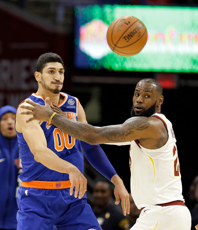 . New York Knicks\' Enes Kanter (00) passes against Cleveland Cavaliers\' LeBron James (23) in the first half of an NBA basketball game, Sunday, Oct. 29, 2017, in Cleveland. (AP Photo/Tony Dejak)
