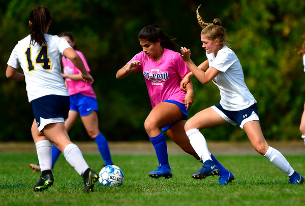 10/12/2019 Mike Orazzi | StaffrSt. Paul's Abbey Stanford (3) and Woodstock Academy's Emma Redfield (6) in Bristol on Saturday. rrr