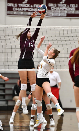 11/14/2019 Mike Orazzi | Staff Bristol Central High School's Kathryn Ross (14) at the net with St. Joseph's Katie Spangenberg (5) during the Class L Second Round Girls Volleyball Tournament at BCHS.
