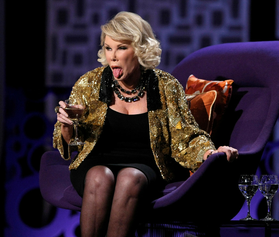 """. Comedienne and roastee Joan Rivers performs at the \""""Comedy Central Roast of Joan Rivers\"""" in Los Angeles on Sunday, July 26,  2009. (AP Photo/Dan Steinberg)"""