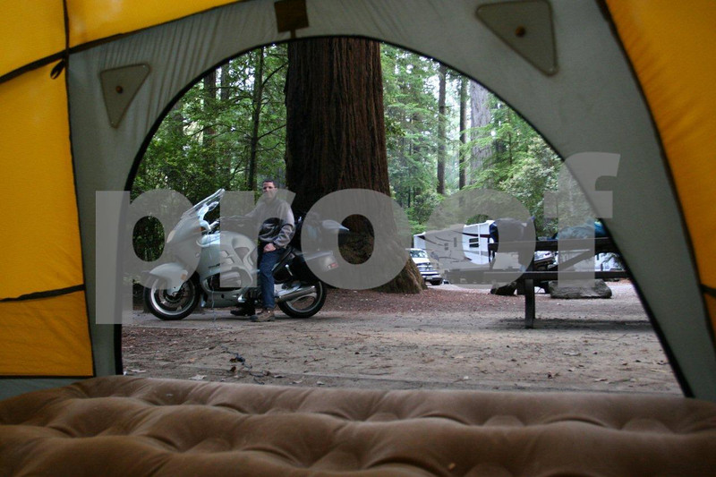 Inflating the air mattress using a 12-volt pump connected to the bike, among the redwoods, J. Smith State Park, CA
