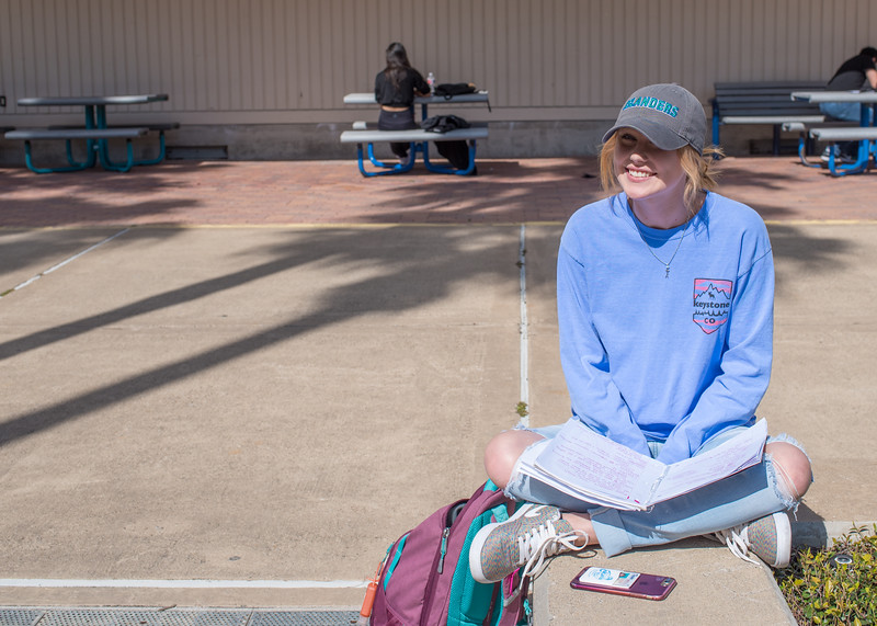 Kassidy Dziuk sits outside in Anchor Plaza studying for her next midterm.