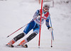 Shannon Duffy hits a gate in the U16 Slalom race at Bosquet Ski Area on February 2, 2014.