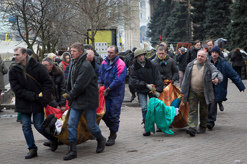 . Bodies of killed anti-government protesters are carried in central Kiev, Ukraine, Thursday, Feb. 20, 2014. A brief truce in Ukraine\'s embattled capital failed Thursday, spiraling into fierce clashes between police and anti-government protesters. (AP Photo/Darko Bandic)