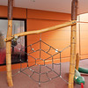 spider web rope climbing net and carved timber spider
