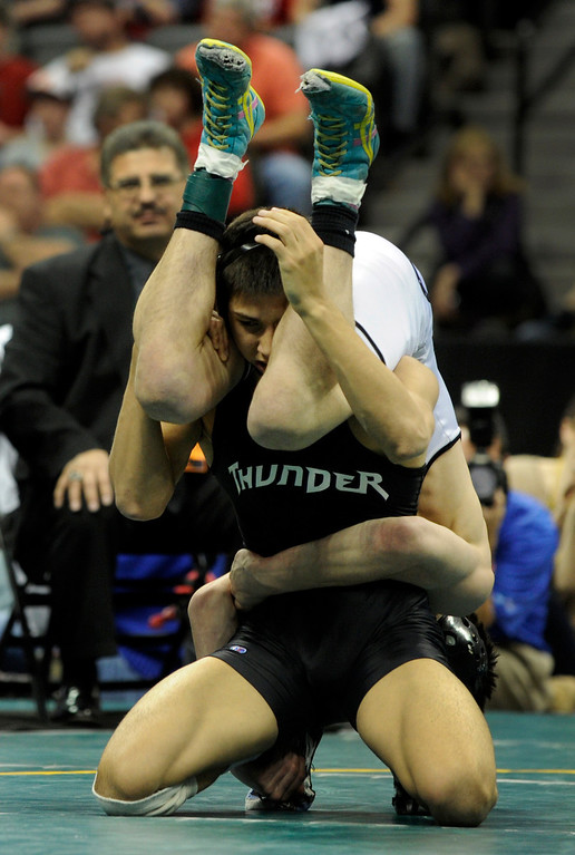. DENVER, CO. - FEBRUARY 23: Pueblo South junior Marcus Martinez, top, found himself hanging upside-down on the back of Discovery Canyon senior AJ Rees, bottom, during a class 4A, 120-pound championship match Saturday night. Rees prevailed to claim the state title. The CHSAA State Wrestling Tournament wrapped up, February 23, 2013, with final matches following the Parade of Champions at the Pepsi Center in downtown Denver. (Photo By Karl Gehring/The Denver Post)