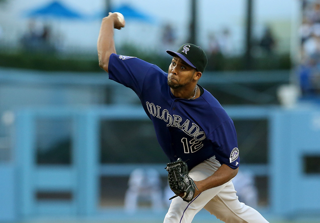 . LOS ANGELES, CA - JULY 12:  Juan Nicasio #12 of the Colorado Rockies throws a pitch against the Los Angeles Dodgers at Dodger Stadium on July 12, 2013 in Los Angeles, California.  (Photo by Stephen Dunn/Getty Images)