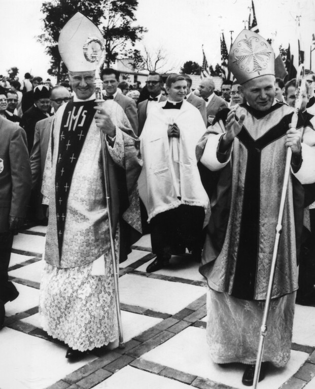 . Cardinal Karol Wojtyla, right, the newly elected Pope John Paul II, waves to the crowd in Doylestown, PA., Sept. 28, 1969, as he walks in procession with Cardinal John Krol, archbishop of Philadelphia. Cardinal Wojtyla, former archbishop of Krakow, Poland, was the first Polish prelate to visit the United States. (Ap Photo)