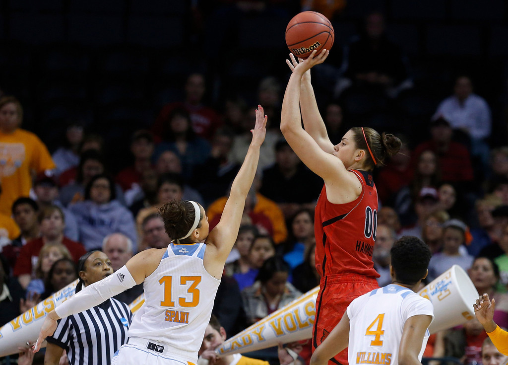 . Louisville forward Sara Hammond (00) shoots over Tennessee forward Taber Spani (13) in the first half of the Oklahoma City regional final in the NCAA women\'s college basketball tournament in Oklahoma City, Tuesday, April 2, 2013. (AP Photo/Sue Ogrocki)
