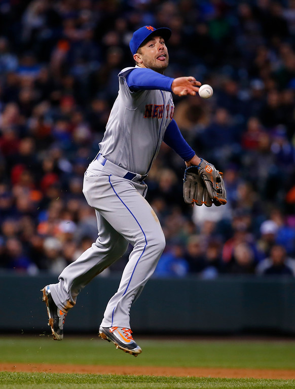 . New York Mets third baseman David Wright tosses the ball to first on a single by Colorado Rockies\' DJ LeMahieu during the fifth inning of a baseball game Saturday, May 14, 2016, in Denver. (AP Photo/Jack Dempsey)