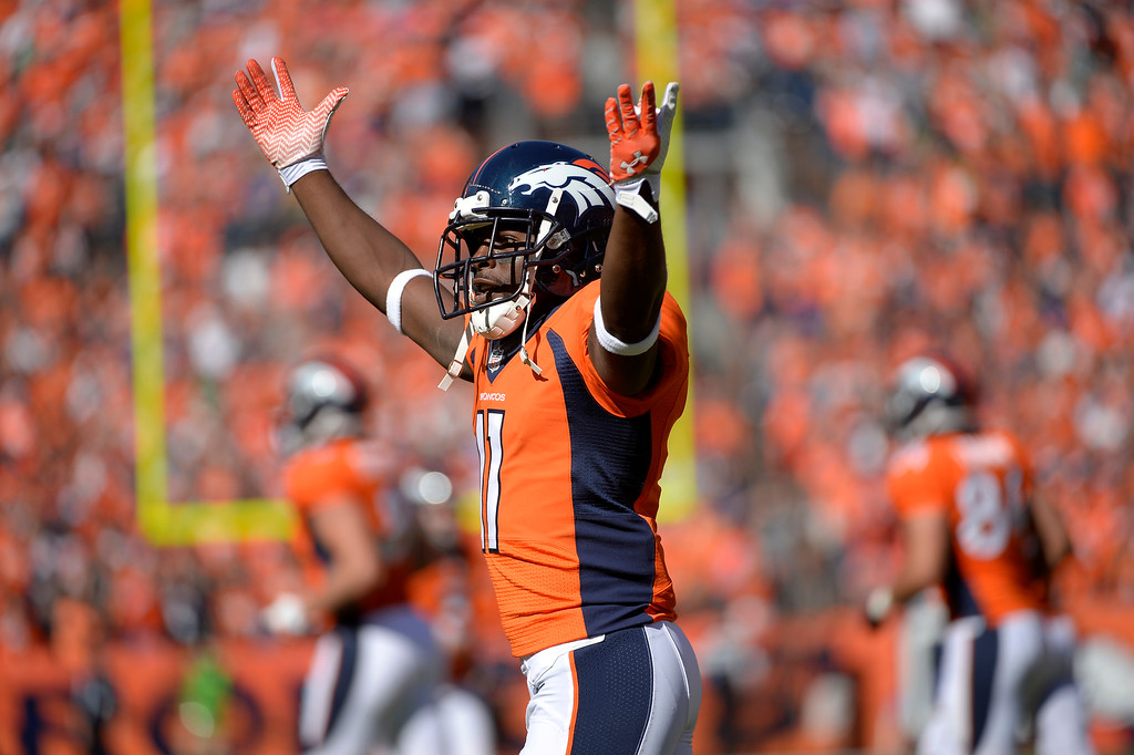 . Denver Broncos wide receiver Trindon Holliday (11) reacts after kickoff return for a Broncos score during the first quarter.  (Photo by Joe Amon/The Denver Post)