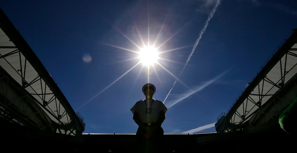 . A members of the British armed forces, providing security at the site, is silhouetted against the sky, at the Wimbledon Tennis Championships in London, Monday July 2, 2018. (AP Photo/Tim Ireland)