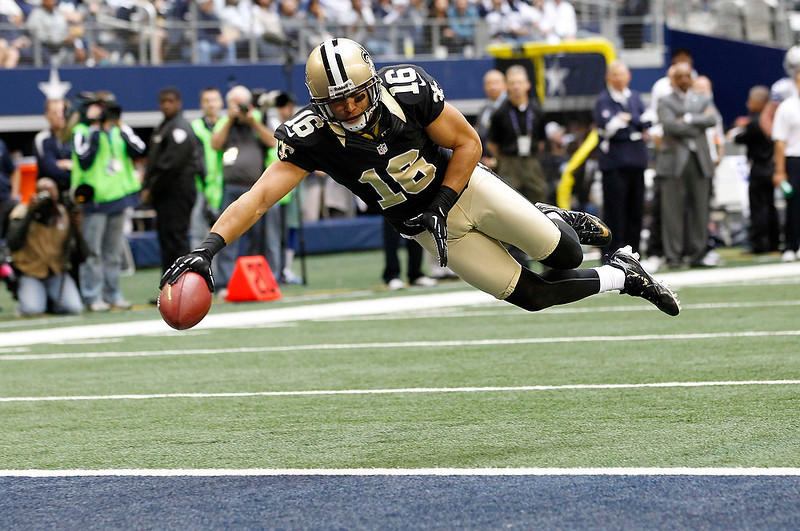 . New Orleans Saints wide receiver Lance Moore dives into the end zone for a touchdown against the Dallas Cowboys in the first half of their NFL football game in Arlington, Texas December 23, 2012.  REUTERS/Mike Stone