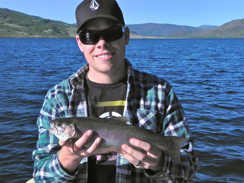 2011/8/8 – Day 3 of our Fish Lake Camping. I was going to rent an aluminum fishing boat, but Chris rented a pontoon boat instead. We had an amazing day of fishing. My Dad caught most of the fish, but Chris had several, including this nice Rainbow Trout.