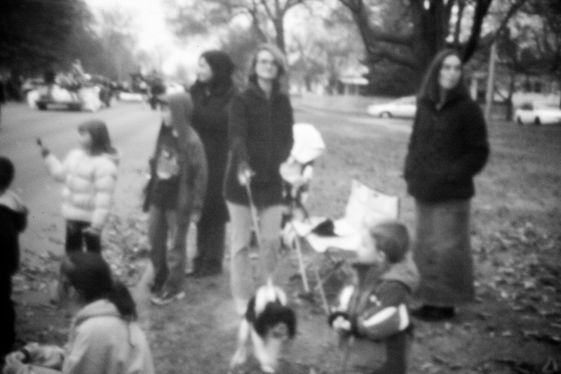 A pinhole photograph of my family during the holiday parade using an old camera body cap and my Canon 5D Mark ii in Mattoon, Illinois on November 20, 2010.  (Jay Grabiec)