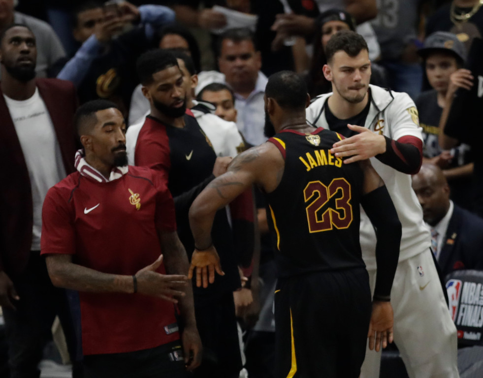 . Cleveland Cavaliers\' LeBron James greets teammates as he taken out in the second half of Game 4 of basketball\'s NBA Finals, Friday, June 8, 2018, in Cleveland. The Warriors defeated the Cavaliers 108-85. (AP Photo/Tony Dejak)