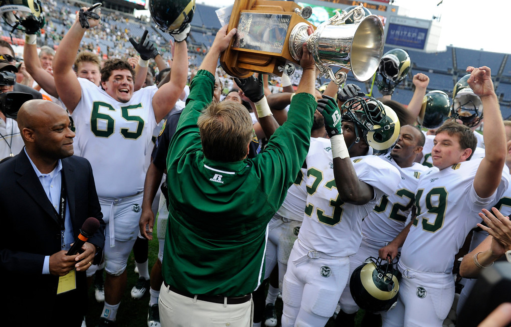 . CSU celebrates its win with the Centennial Cup. The University of Colorado football team takes on Colorado State University for the Rocky Mountain Showdown at Sports Authority Field at Mile High in Denver on Saturday, Sept. 1, 2012. Kathryn Scott Osler, The Denver Post